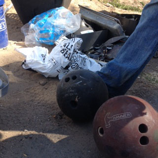 We found bowling balls! One of ILACSD's staff managed to shot put these guys into the dumpster